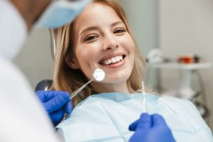 The dentist recommends the patient to have teeth whitening treatment.