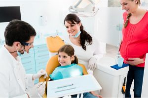 mother and daughter for dental visit