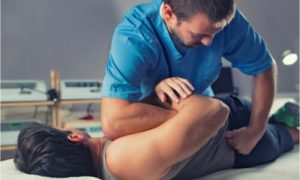 The patient receives chiropractic treatment.