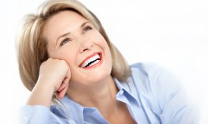 a healthy woman showing her great smile